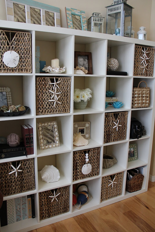 shell and wicker decorated bookshelf